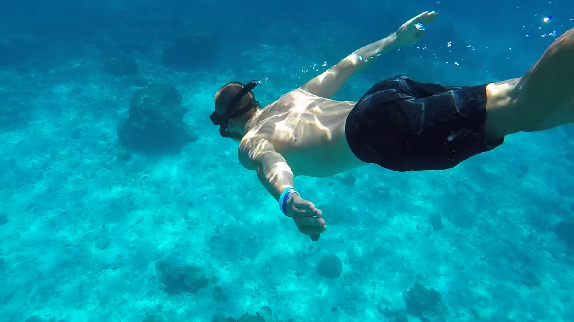 videoblocks-young-man-diving-deep-in-clear-blue-water-snorkeling-guy-hd-underwater-gopro-slow-motion-andaman-thailand_seseqhqb5e_thumbnail-full11